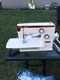 white and red portable sewing machine