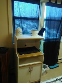 brown and white wooden cabinet with shelf