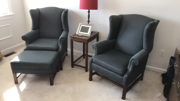 Green upholstered armchairs