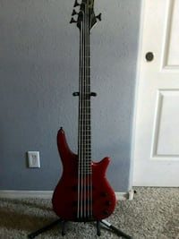 red and black bass guitar