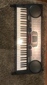 black and gray Casio electronic keyboard