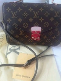 black and brown Louis Vuitton monogram leather han