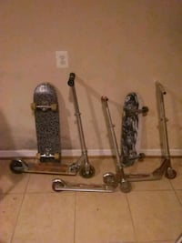Two Razor scooters and two skate boards