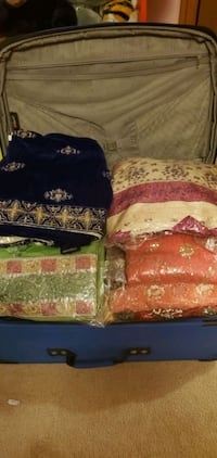 Suitcase and Unstitched Suits and Saris
