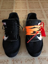 pair of black-and-white Nike running shoes 38 km