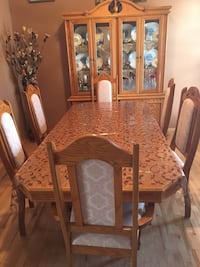 Brown wooden dining table set with Credenza Chestermere