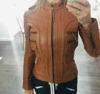 Real leather jacket. Fits xs or small. Worn only a few times. Slim fit. In great condition. New Westminster, V3L 2Z6
