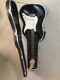 black and white stratocaster electric guitar with case