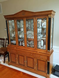brown wooden display cabinet filled with ceramic dinnerware set Gaithersburg, 20882