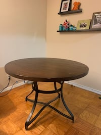 round brown wooden table with black steel base Washington, 20024