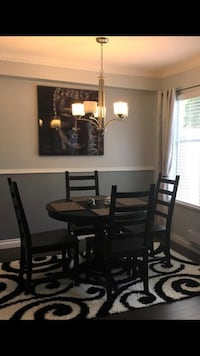 Round black ikea extendable table with 4 chairs. Maple Ridge, V2X 1Z3