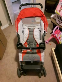 baby's red and black stroller Edmonton, T5P 2S1