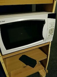 white and black microwave oven 544 mi