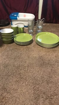 green ceramic dinnerware; four clear drinking glasses 935 mi