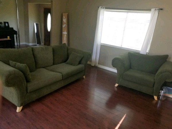 green fabric 2-seat sofa