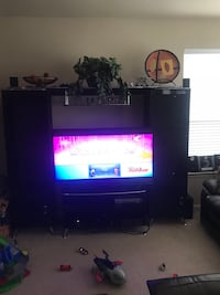 Black and silver entertainment center ONLY. The tv is NOT for sale Pearland, 77584