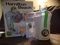 white and green Hamilton Beach juice extractor wit