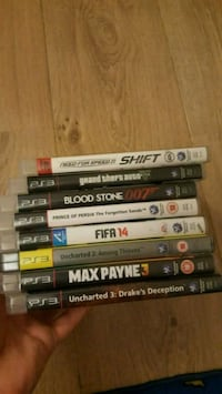 assorted Sony PS3 game cases Reading