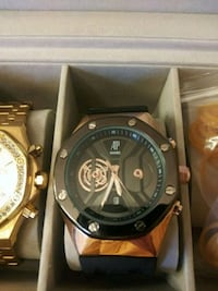 round black chronograph watch with gold link bracelet in box San Antonio, 78228