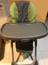 black and green Graco high chair Miami, 33170