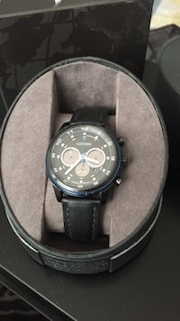 round black chronograph watch with black leather strap Vancouver, V5Y 0H6