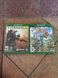 two Titanfall and Sunset Over Drive Xbox One game cases Sherbrooke, J1R 0E2