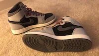 pair of black-and-white Nike sneakers 23 mi
