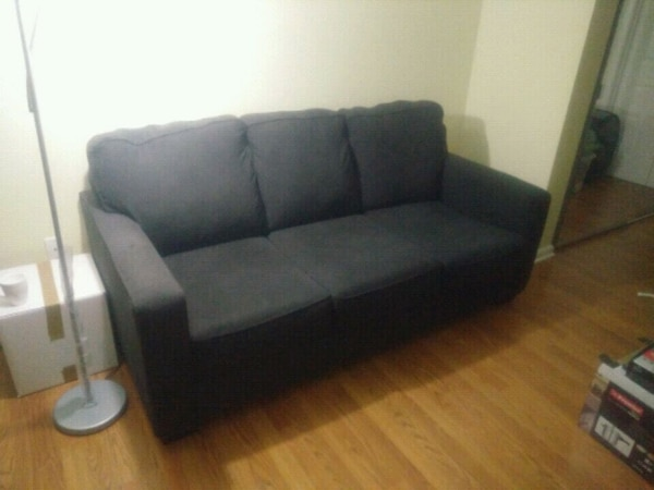 used large black couch with pullout mattress for sale in sunnyvale