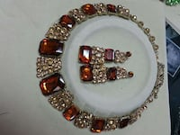 orange gem stone embellished necklace and pair of earrings Wasilla, 99654