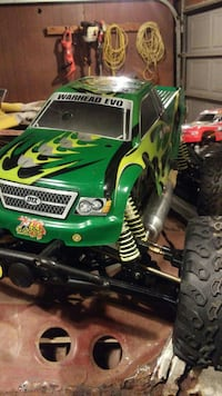 green, yellow, and black monster truck RC toy