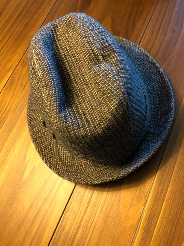 brown and black knit cap 54687be9-4700-468e-a2d2-3bf941feea7d