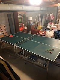 Folding ping pong table with underneath storage