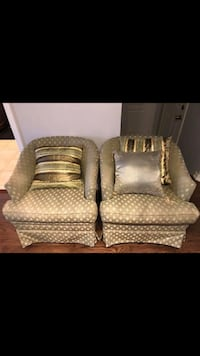 Two brown leather sofa chairs