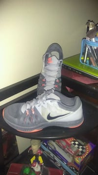 pair of grey & orange Nike training shoes North Little Rock, 72120