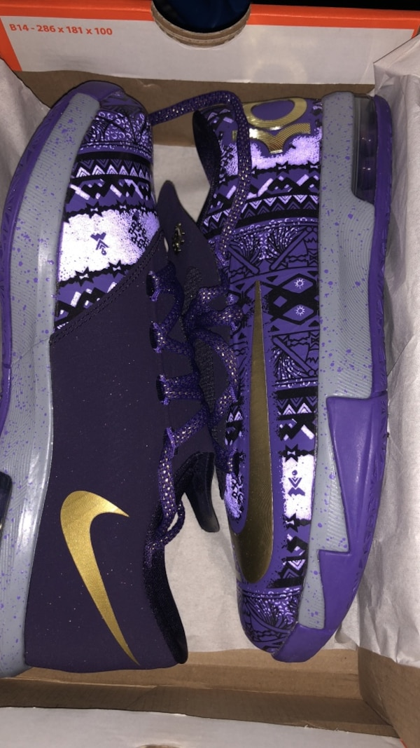 Pair of purple-and-gray nike sneakers with box