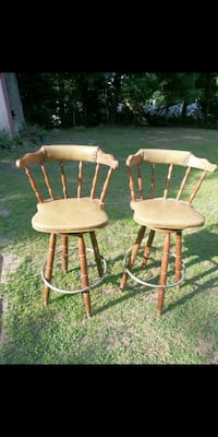 Two wooden bar stools and a kitchen organizer