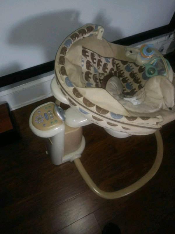white and brown Fisher-Price cradle and swing