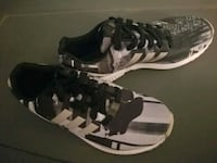 pair of black-and-white Adidas sneakers Fairfax