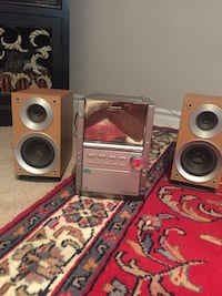 Two gray-and-brown speakers.. works well