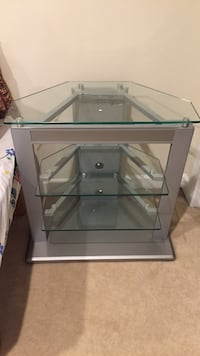 Gray metal framed glass top tv stand Sterling, 20166