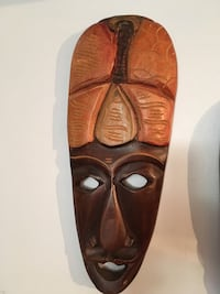 brown wooden tribal mask wall decor
