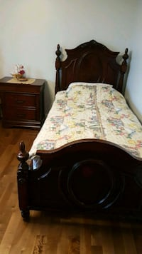 brown wooden bed frame with white and pink floral  Montréal, H4R 3J5