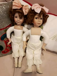 two female dolls in white and red dresses Lakeshore, N0R 1C0
