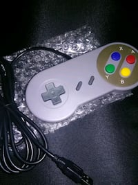 white and purple Nintendo 64 game controller