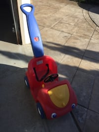 red and blue Little Tikes cozy coupe