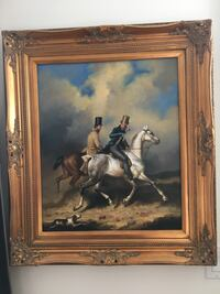 brown wooden framed painting of men riding horses