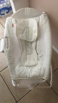 Baby's white and gray Fisher-Price rock and play sleeper