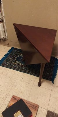 Folding corner/ end table. Heavy wood, nice condition