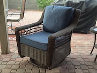 Brown wicker chair, swivels and rocks 1957 mi
