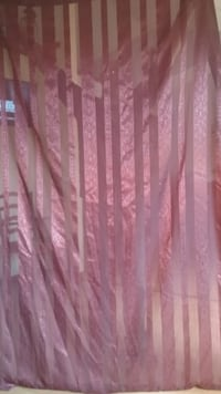 Two Sheer curtains. Maroon in color Coon Rapids